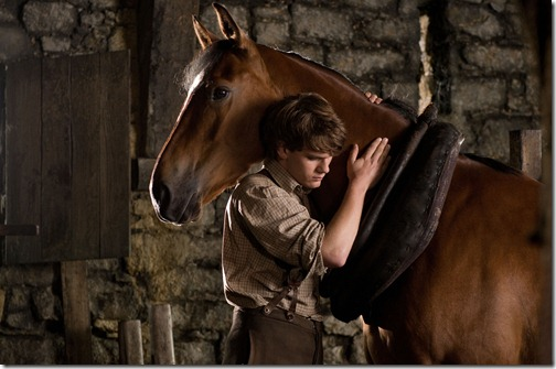 """""""WAR HORSE""""..DM-D27-0283..Albert (Jeremy Irvine) and his horse Joey are featured in this scene from DreamWorks Pictures' """"War Horse"""", director Steven Spielberg's epic adventure and an unforgettable odyssey through courage, friendship, discovery and wonder...Ph: David Appleby..©DreamWorks II Distribution Co., LLC. All Rights Reserved."""