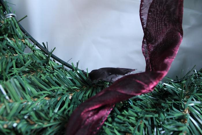 Wrapping ribbon around wreath