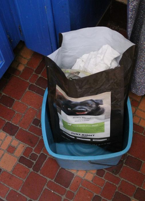 Repurposing a dog food bag as a trash bag