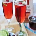 Recipe: Bare Cranberry Pomegranate Bellini With Lime